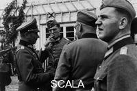 ******** Claus Graf Schenk von Stauffenberg during a briefing of officials in the occupied Poland. Helmut Schaefer. On the left von Loeper.