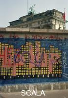 ******** The Berlin Wall with graffiti and the Brandenburger Gate in the background, summer 1989
