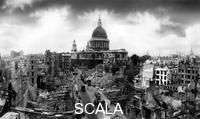 ******** View of London showing bomb damage to St Paul's Cathedral, 5th November 1941. St Paul's survived the Blitz, despite being bombed on several occasions. This photograph shows that many of the surrounding buildings were less fortunate.