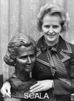 ******** Margaret Thatcher pictured with a bronze bust at the House of Commons, 12th November 1975.