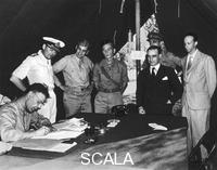 ******** Signing the armistice in Cassibile, September 3rd, 1943. Generals Lowell Rokes, Giuseppe Castellano, Kenneth Strong, and Walter Bedell Smith (signing) are recognizable in this shot.