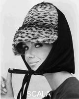 French, John (1907-1966) Nicole de la Marge in an Otto Lucas jersey scarf over an ocelot hat, for The Sunday Times. London, UK, 1964.
