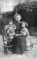 ******** Marie Curie, Polish-born French physicist, with her daughters Eve and Irene, 1908.
