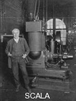 ******** Thomas Alva Edison, American inventor, with his first dynamo for producing electric light, 1880s.
