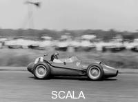 ******** Peter Collins in a Ferrari Dino, British Grand Prix, Silverstone, 1958.